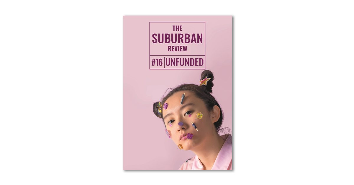 ART: Cover for The Suburban Review #16: UNFUNDED entitled 'Unfolding' by Amy Yang. Above, the magazine's logo in a purple-burgundy against a light pink background. Below, a young Asian woman looks to the viewer with a neutral expression. Her hair is up in pigtail buns and she has a pink dot under each eye. She wears a light pink silk shirt and has seven colourful resin earrings stuck to her face and two more in her hair.